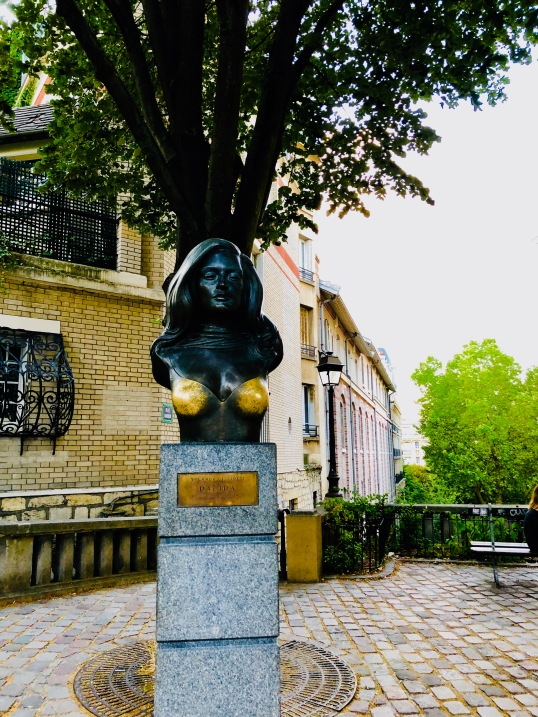 The monument to Dalida in Montmartre, where apparently people think rubbing her breasts will bring good luck. So much for respect in death...